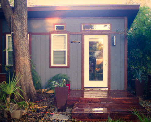 A front view of the deck and front door of the Tuff Shed home.