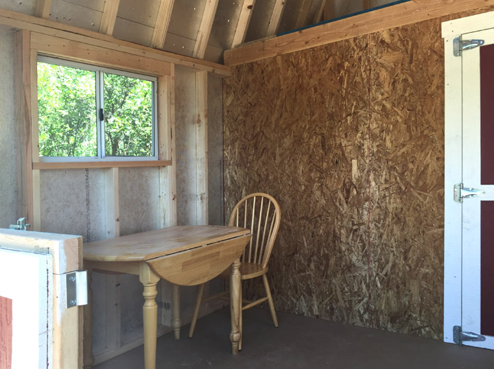 Used As Both A Storage E And Playroom This Pro Tall Barn Does Double Duty The Highly Custom Dutch Doors With Wainscot Trim In Door