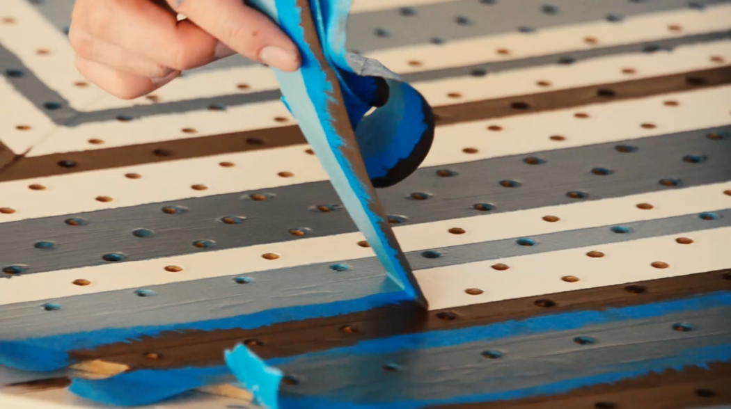 Pull the tape off the pegboard away from your body.