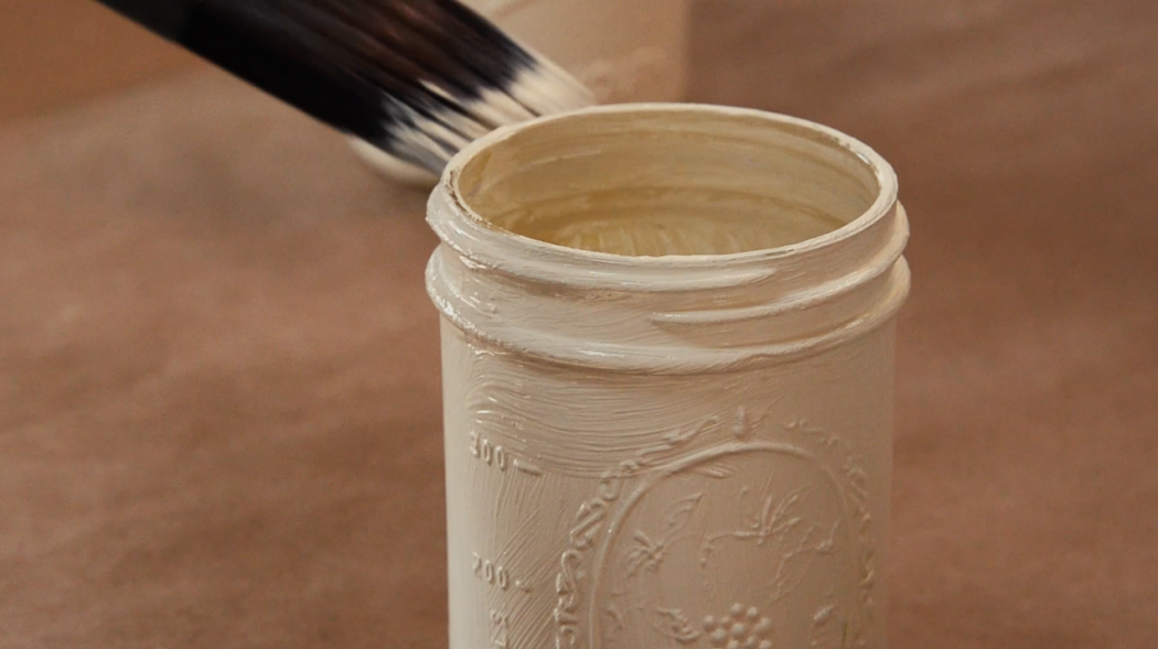 Apply several coats of chalk paint to the mason jar for even color.