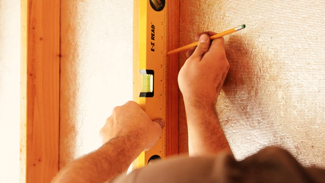 Measure the height for your lamp and mark a level line on the wall.