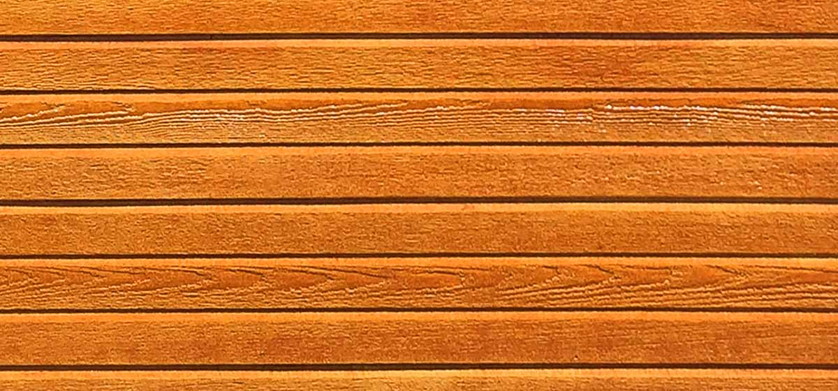A closeup view of our new lap siding, shown in cedar stain.