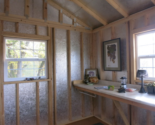The view of the interior of the Cabin, with shelving and decor.