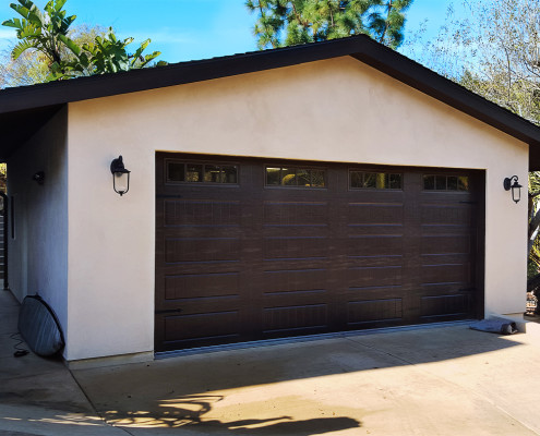 The two car stucco garage houses outdoor sports items for the owners.
