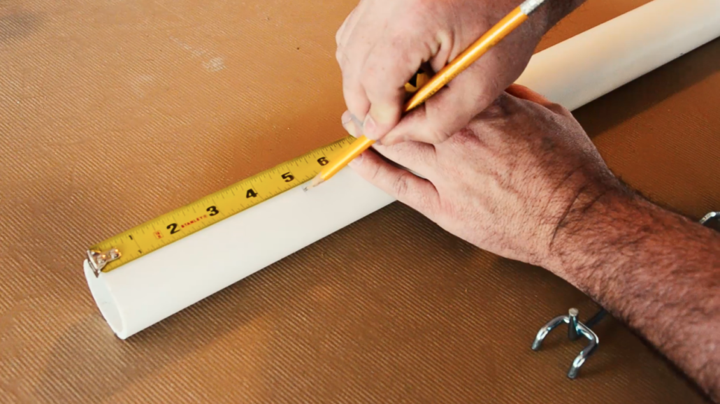 Start by measuring the length of the pegboard hook to your PVC pipe.