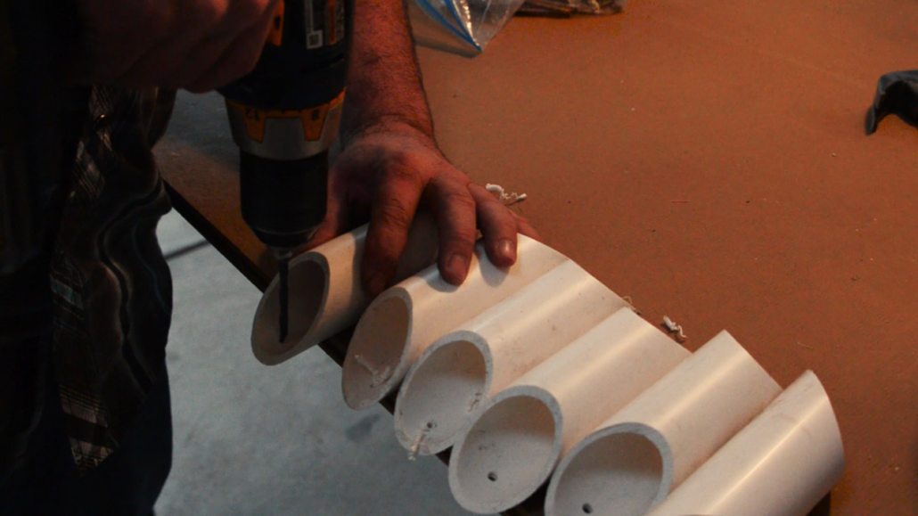 Predrill holes in open ends the PVC pipe where it will be attached to the board.