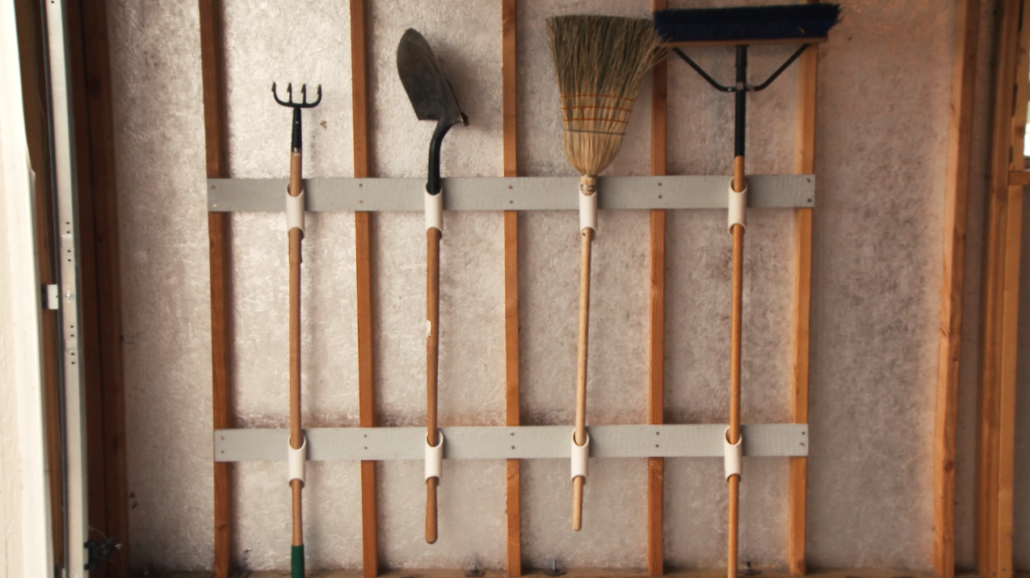 Store your long-handled tools with this easy wall organizer.