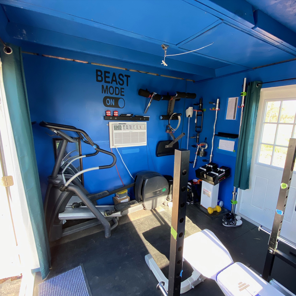 Chris' Gym Shed has room for all his workout equipment.